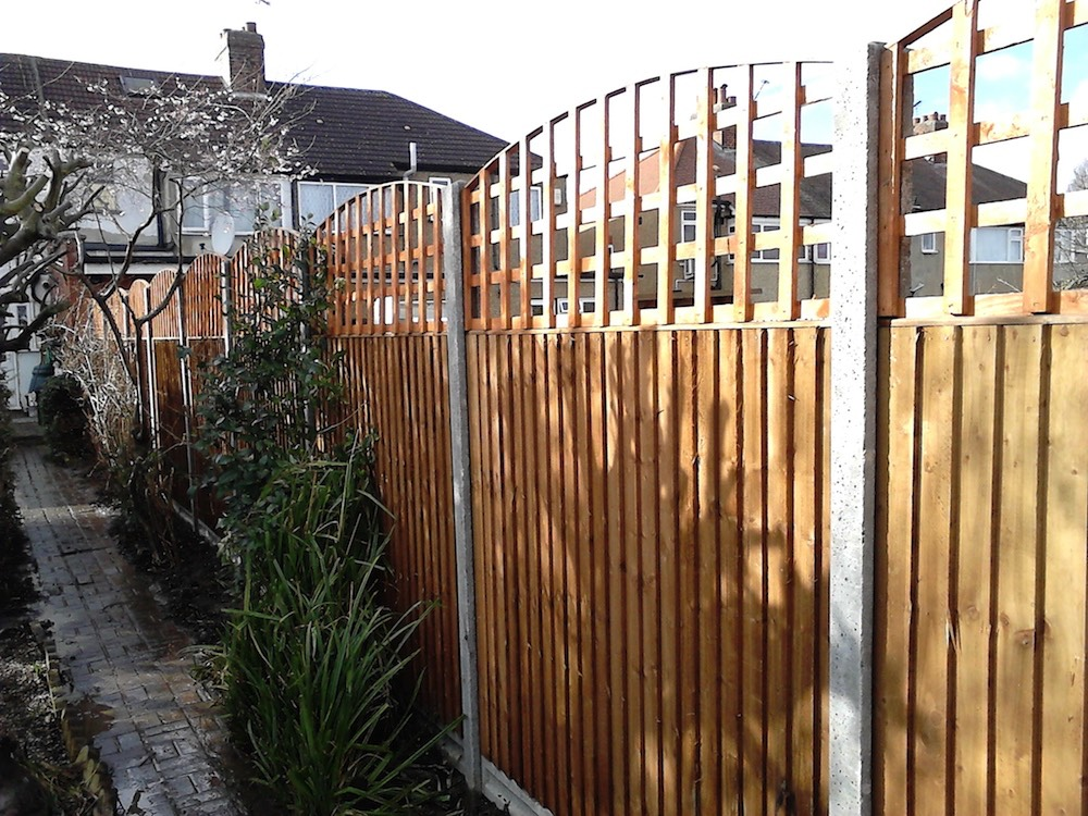 A wooden garden fence built by apex  property services