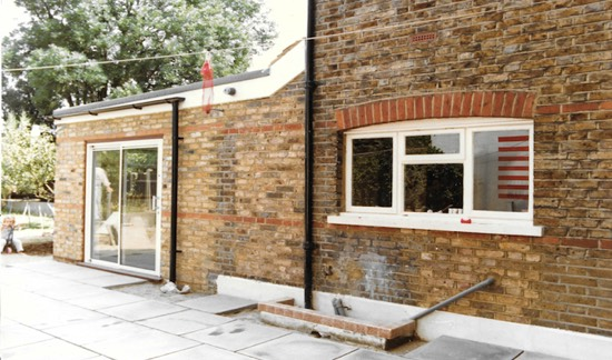 a house extension with sliding glass doors built by apex