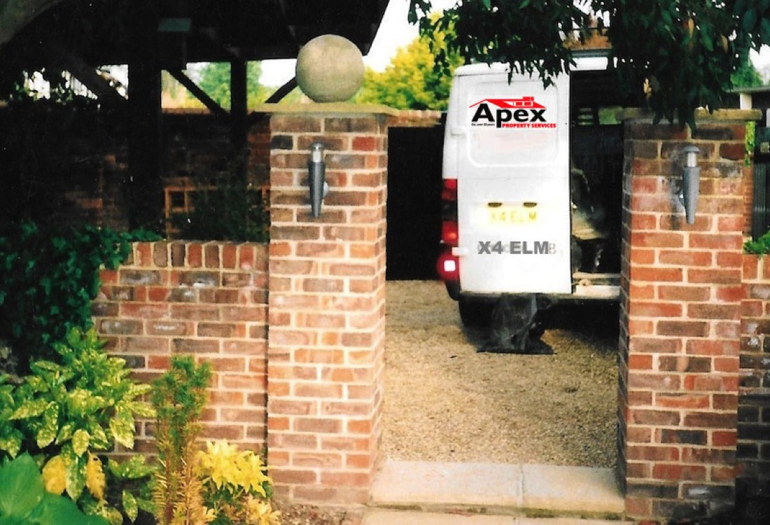 A front garden brick wall built by apex property services